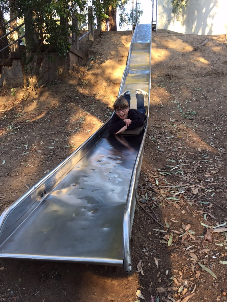 Going down a slide with cardboard
